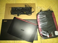 Acer Nitro 5 Gaming Laptop with backpack and laptop sleeve.