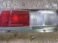 Nissan Caravan E25 left side rear tail lamp.