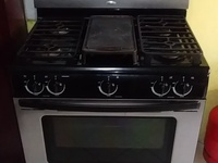 Whirlpool five burner gas stove and oven