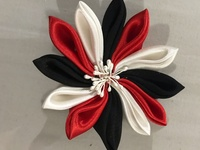 Red Black and White Broach