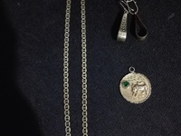 10K Gold, weight 17.7 grams with emerald green birthstone.