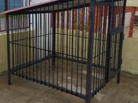 Solid steel kennel with celing to protect from heat...