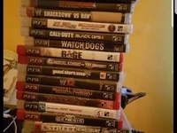 PS3 with 25 games 4 controls and charging dock