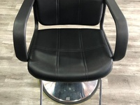 Saloon chair or barbering chair