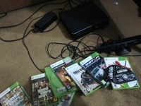 Xbox 360 with 2 controls and games