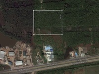 Eight Acres of Land, Caroni off Highway