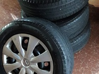 Steel rims and tyres with caps