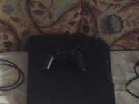 PS3 with 5 games, power cord, charger and 1 controller