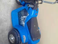 Kids ride on atv and blow up toy