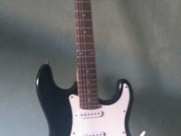 Electric guitar with amp extra strings and others