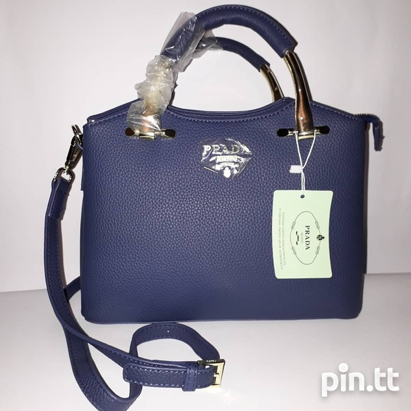 Blue Prada handbag