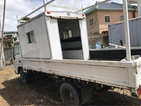 Truck passenger canopy with goods rack and tool box