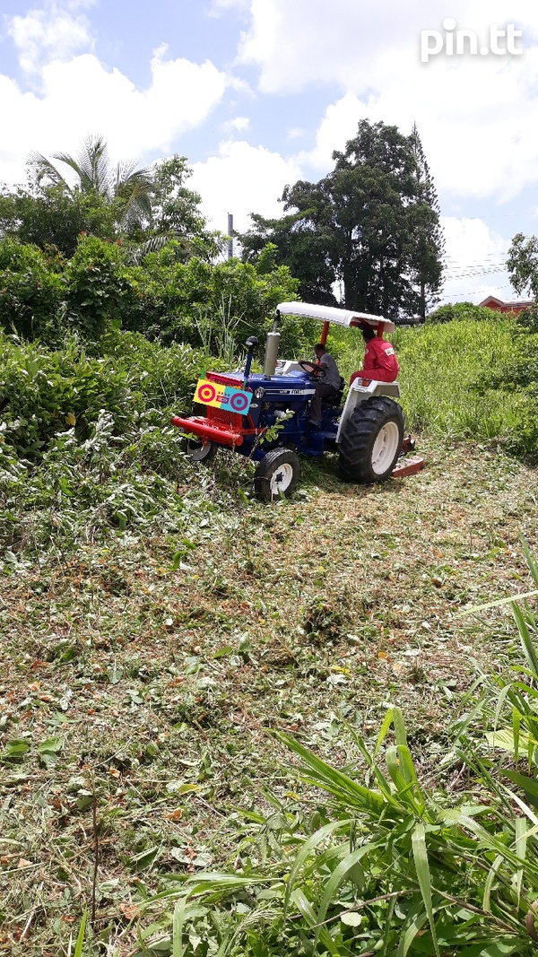 Tractor grass cutting