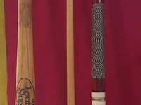 four piece pool cue and Baseball bat