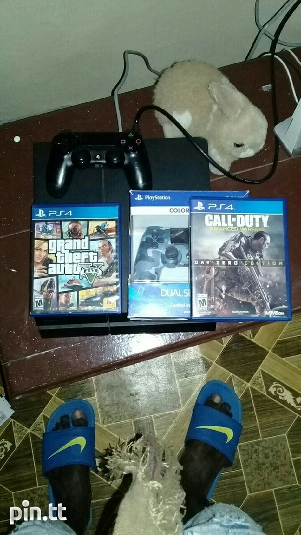 PS4 with two games and two controllers-1