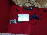 PS2 console with controllers and pwr cord.Games included
