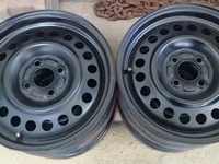 15 inch NISSAN steels close hole