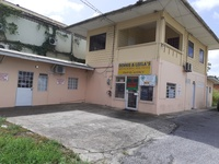 4 lots commercial land with building in Sangre Grande