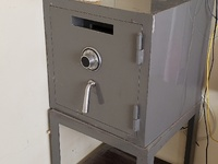 Steel safe with deposit entry slot