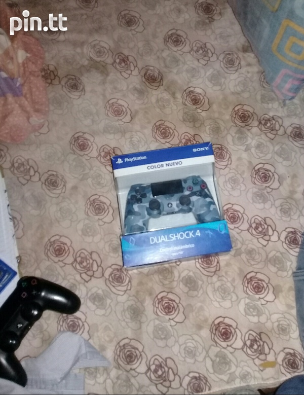 PS4 with two games and two controllers-2