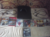 PS3 with 8 games, power cord, charger and 1 controller