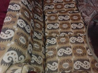 Used beige and green patterned 3 seater couch