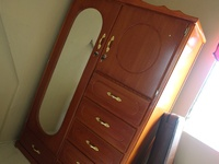 Wardrobe with gold handles.