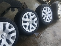 16'' 6 hole steel rims and tyres with hub caps