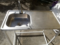 Sink with stand and pipe
