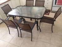 Glass table with 6 chairs.