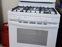 Frigidaire Stove Cast Iron Grill slightly used owner Moving