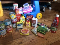 Used shopping set little tikes cart, cash register and grocery items.
