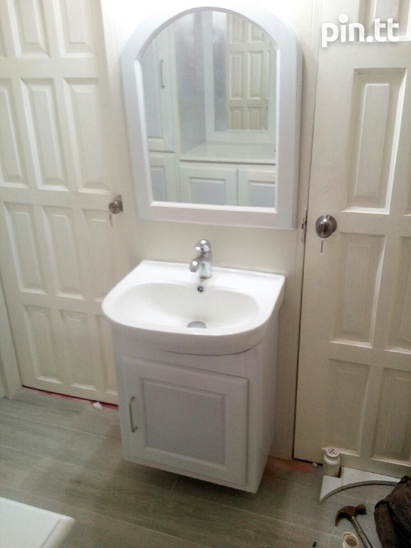Sink with cupboard and mirror frame
