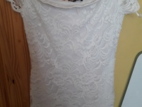 White dress with lace over lay