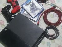PS4 with cables, controllers and 2 games