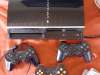 PS3 with 3 controls and 4 games
