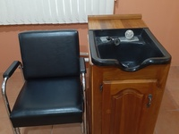 Hair dressing sink, stand and chair.
