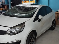 Kia with Damaged Roof