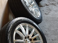 Silver and Blue Rims and Tyres