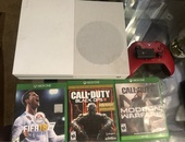 Xbox 1 s with controller, battery pack, 3 games